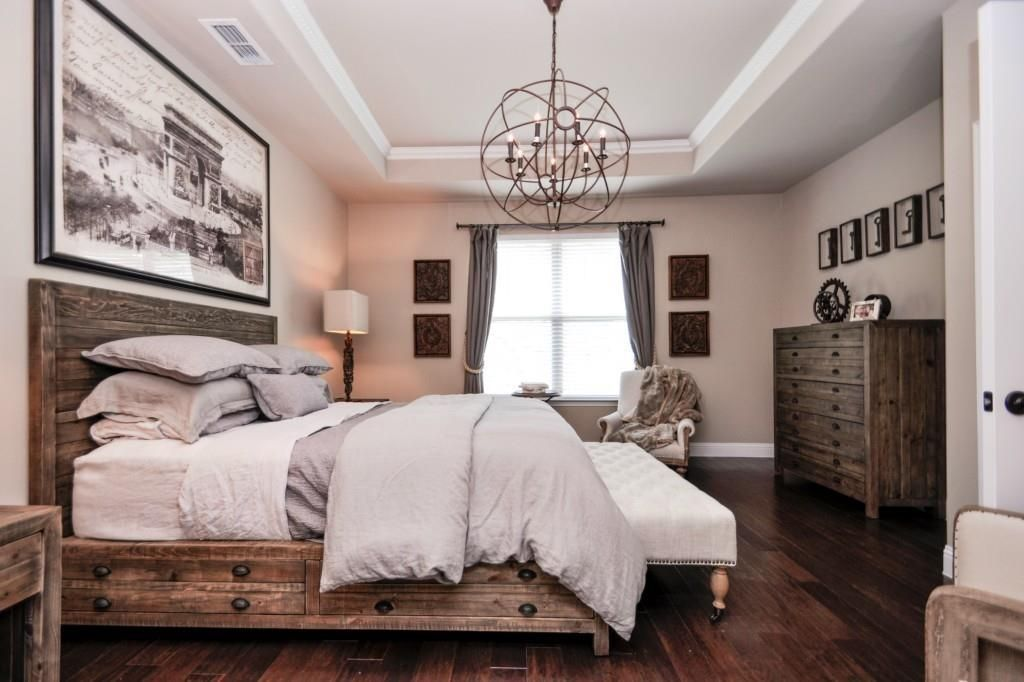 Give your room a little personality with a unique spin on the classic chandelier this rustic Modern chic master bedroom