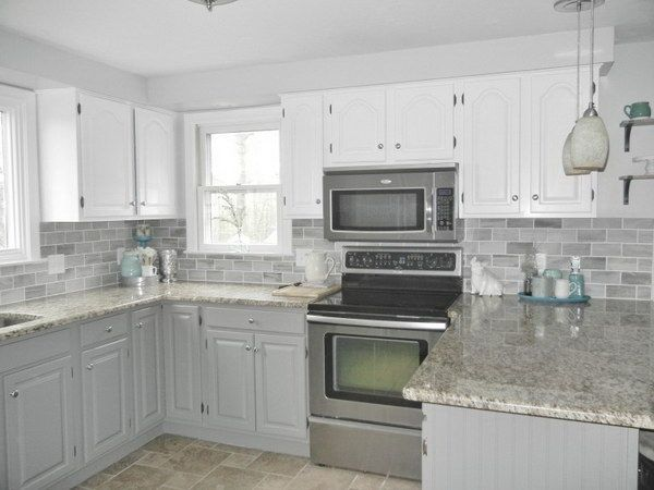 Two Toned Gray And White Cabinets Marble Subway Tile Carrara Countertops A Big Farmhouse Sink And Cherry Cabinets Kitchen Kitchen Renovation Kitchen Marble