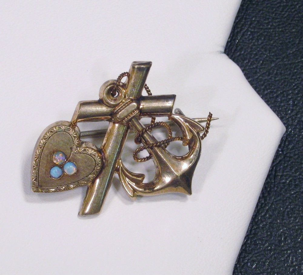 Antique gold brooch with a heart motif