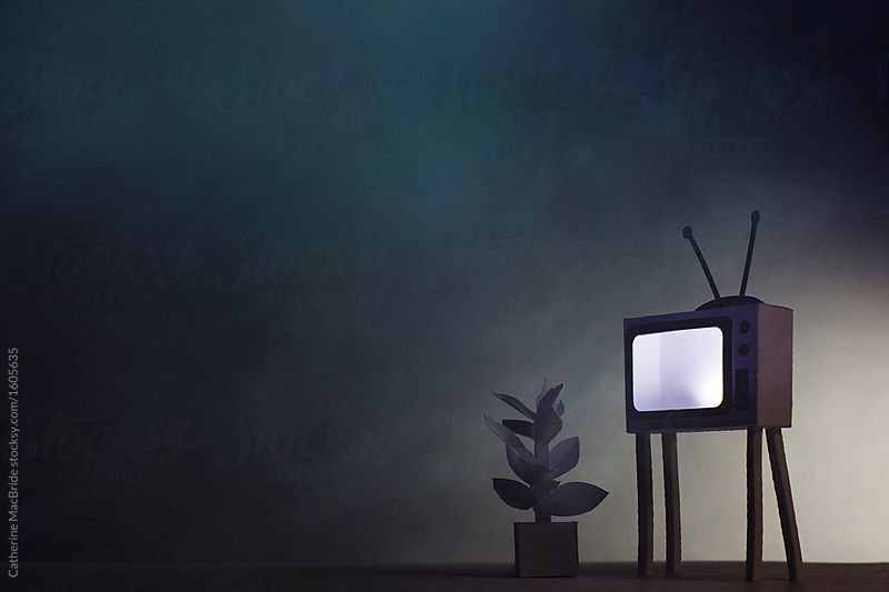 A Paper Television Transmits White Noise To An Empty Room At Night
