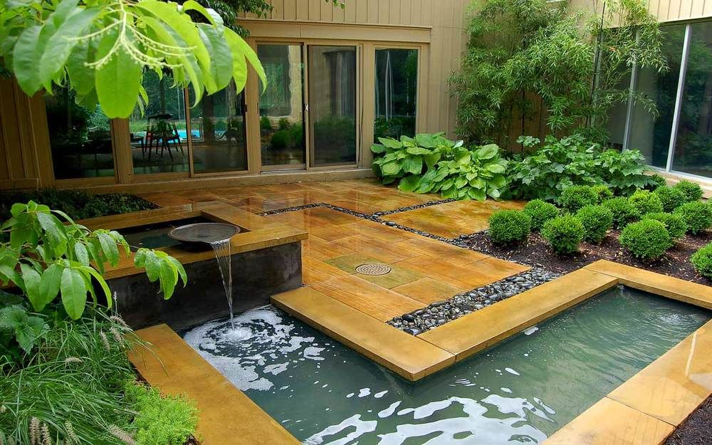 L-shaped water feature with river stone | Water features ... on L Shaped Backyard Layout id=56469