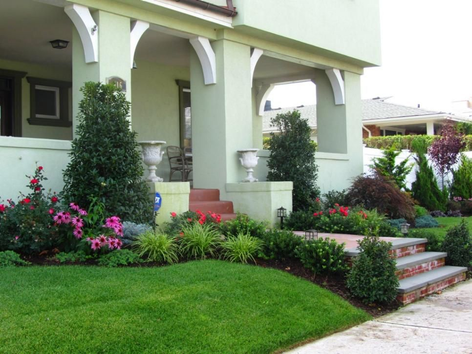 a tiny front yard still leaves room for curb appeal  an attractive walkway and tall shrubs on