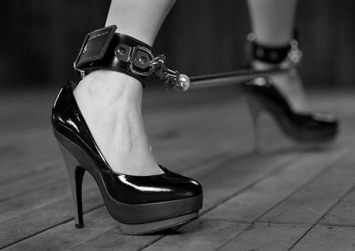 High heel spreader bar bondage