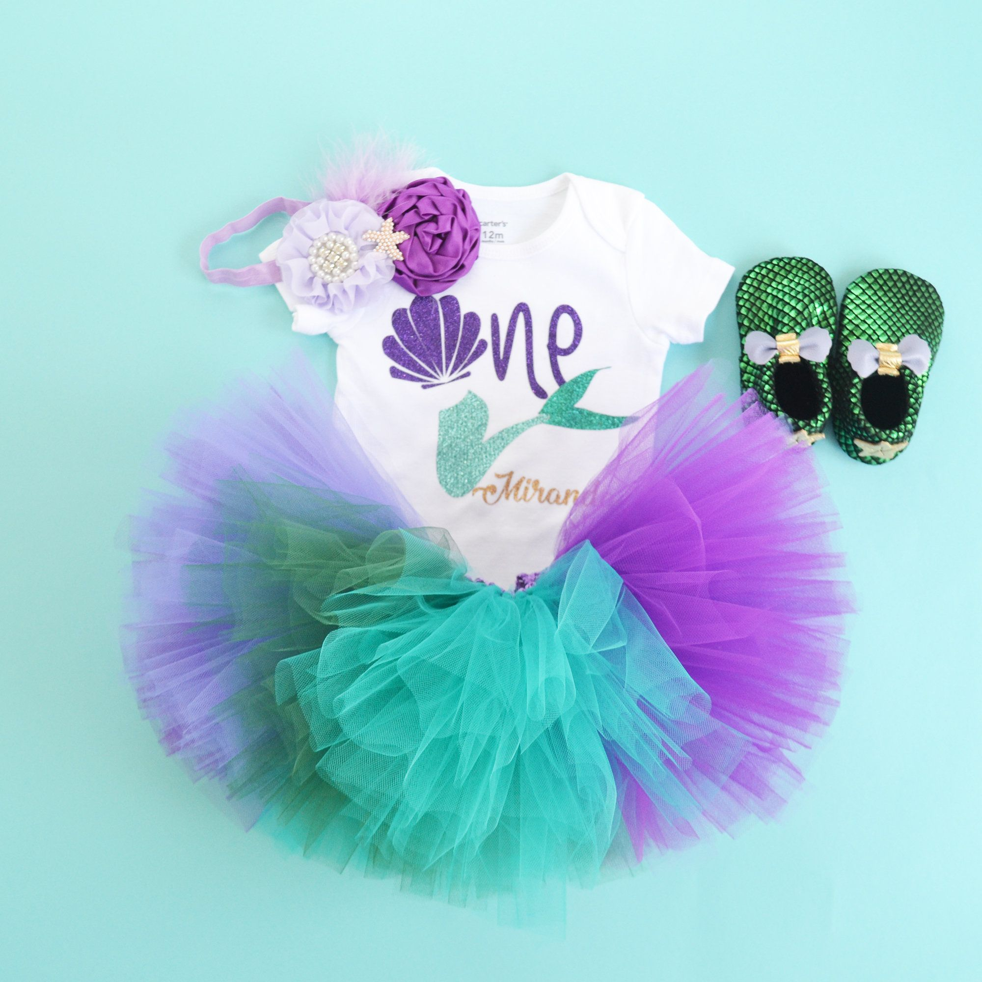 Under the sea first Birthday outfit, little mermaid outfit, Aqua lavender tutu, sea shell bodysuit. Shoes are not included. #birthdayoutfit
