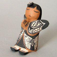 Storytellers Snowflake Flower (Stephanie Rhoades) of Cochiti Pueblo