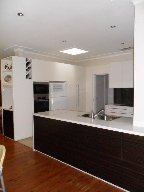 Overall view of kitchen showing pantry, wall oven space and fridge ...