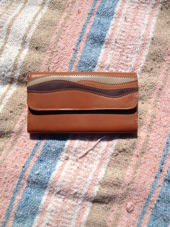 Awesome vintage wallet. Perfect size & cool leather print.