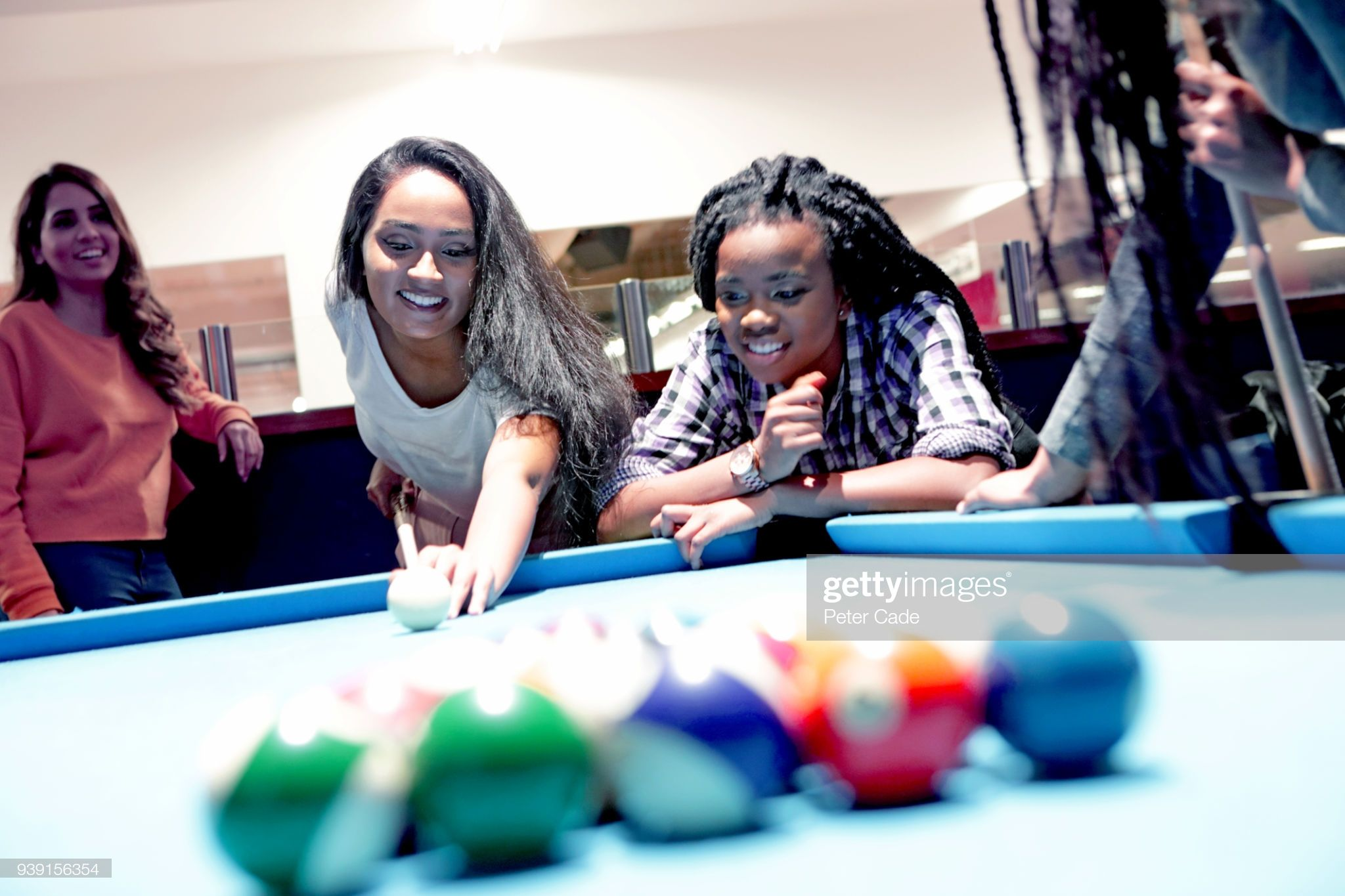 Stock Photo Group of girls playing pool Stock photos