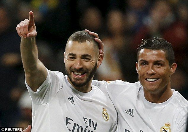 The Los Blancos star (right) celebrates with team-mate Karim Benzema during Sunday's win over Sevilla