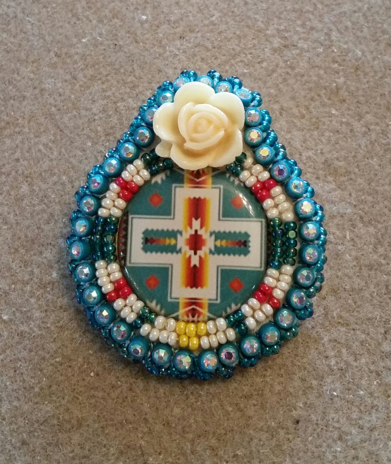 Native American Beaded Earrings with a Pendleton blanket design cabochon  and epoxy flower by AweyoDesigns on Etsy