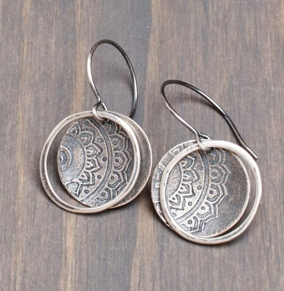 An etched sterling silver lotus pattern exclusively designed and cast by Original Hardware makes for a classic but earthy earring style. Two 1-inch discs are hand-shaped into delicate cups, then framed by an organic shaped sterling silver component. Sterling silver ear wires. Approximately 1 1