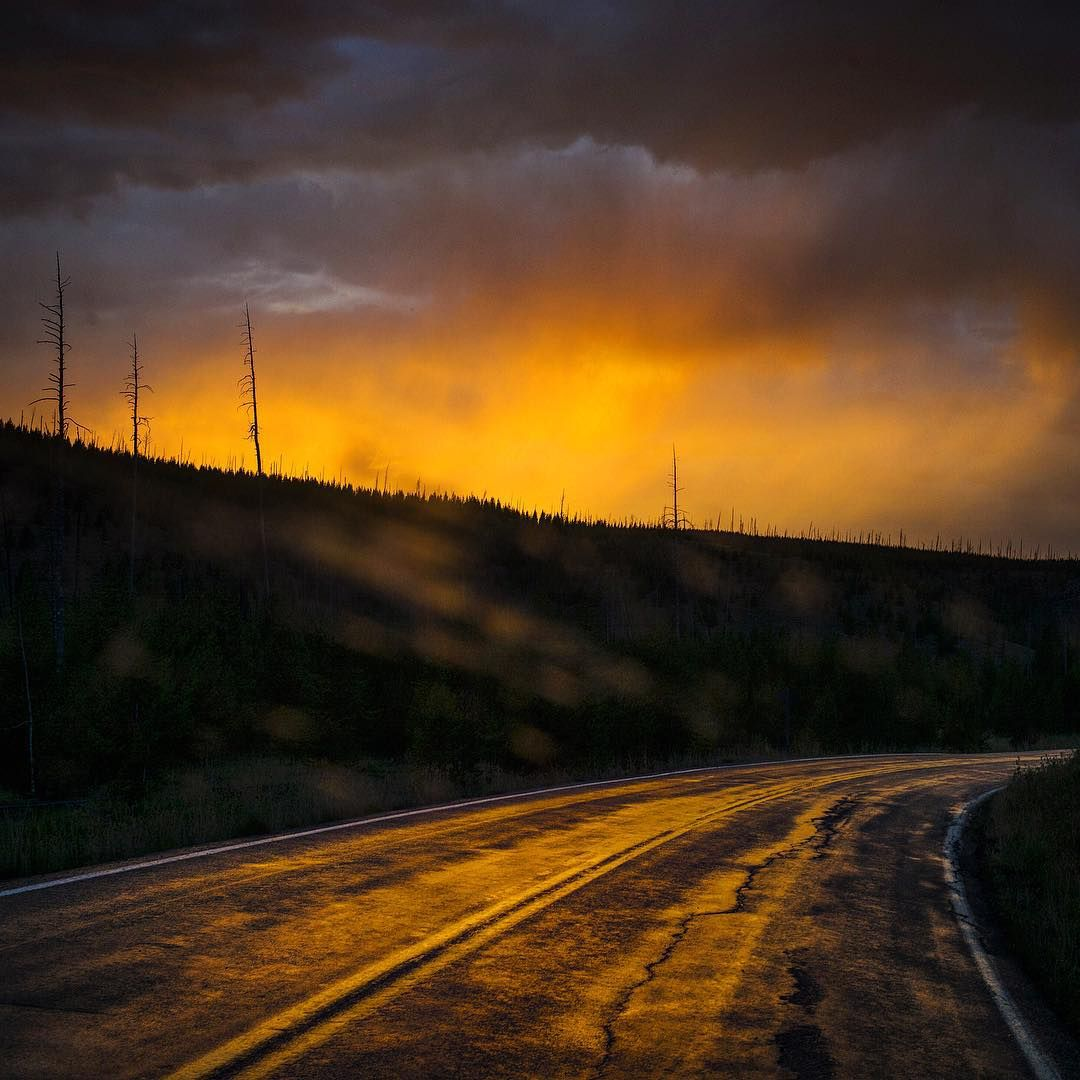 Driving home from Idaho to Wyoming to Montana through Yellowstone National Park. The rain suddenly stopped and the sky was ablaze with color when the sun went down. Photo by David Guttenfelder @dguttenfelder