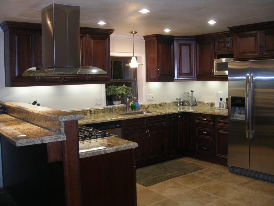Kitchen Superb Kitchen Remodels With Brown Kitchen Cabinets Storage Marble Countertop With Refrigerator Above Ceramic Floor Making the Kitchen Remodels