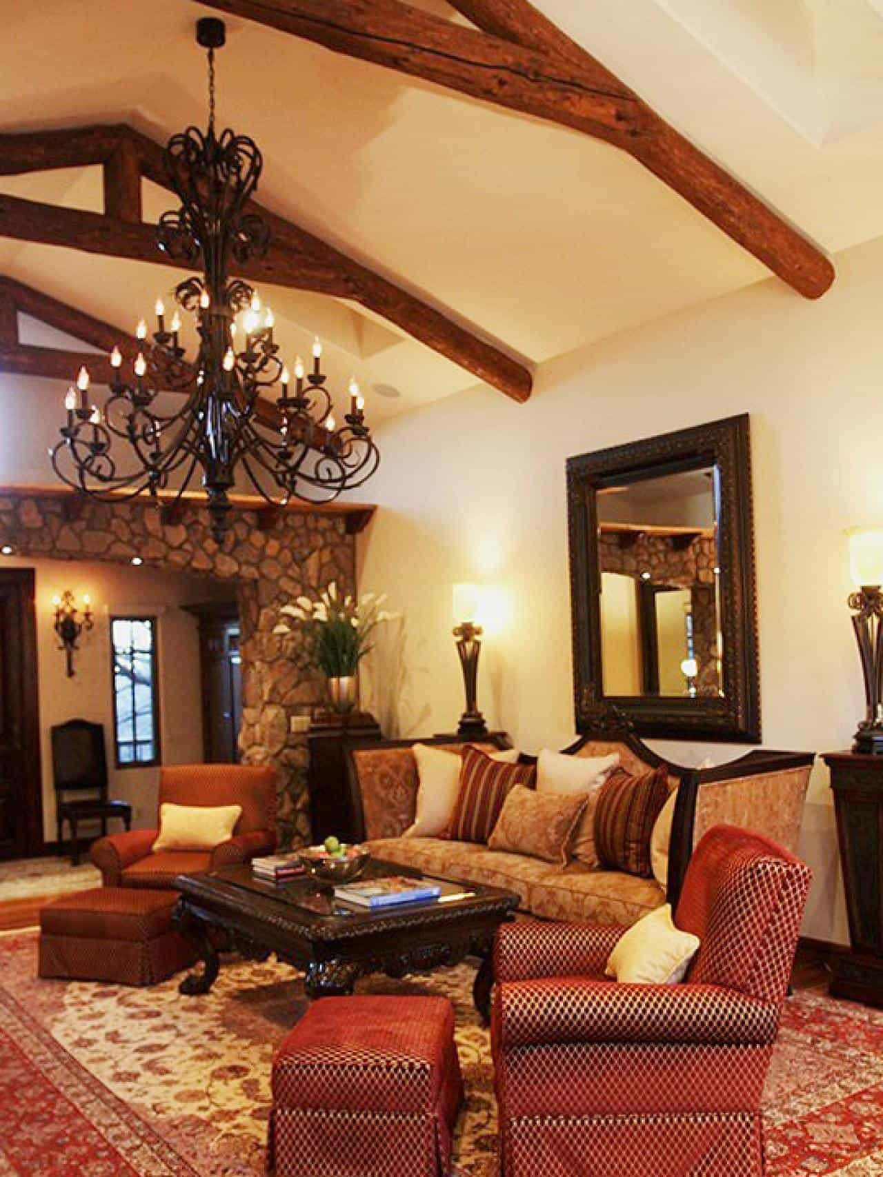 Living Room With Large Wrough Iron Chandelier And Spanish Style Furniture Dashing