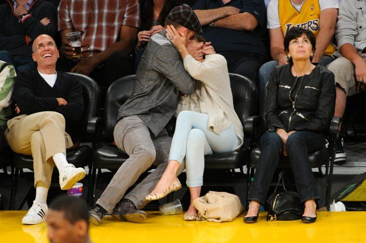 Pin for Later: 46 Photos of Justin Timberlake and Jessica Biel's Love Through the Years  They embraced for the cameras while sitting front row at a May 2012 Lakers game.