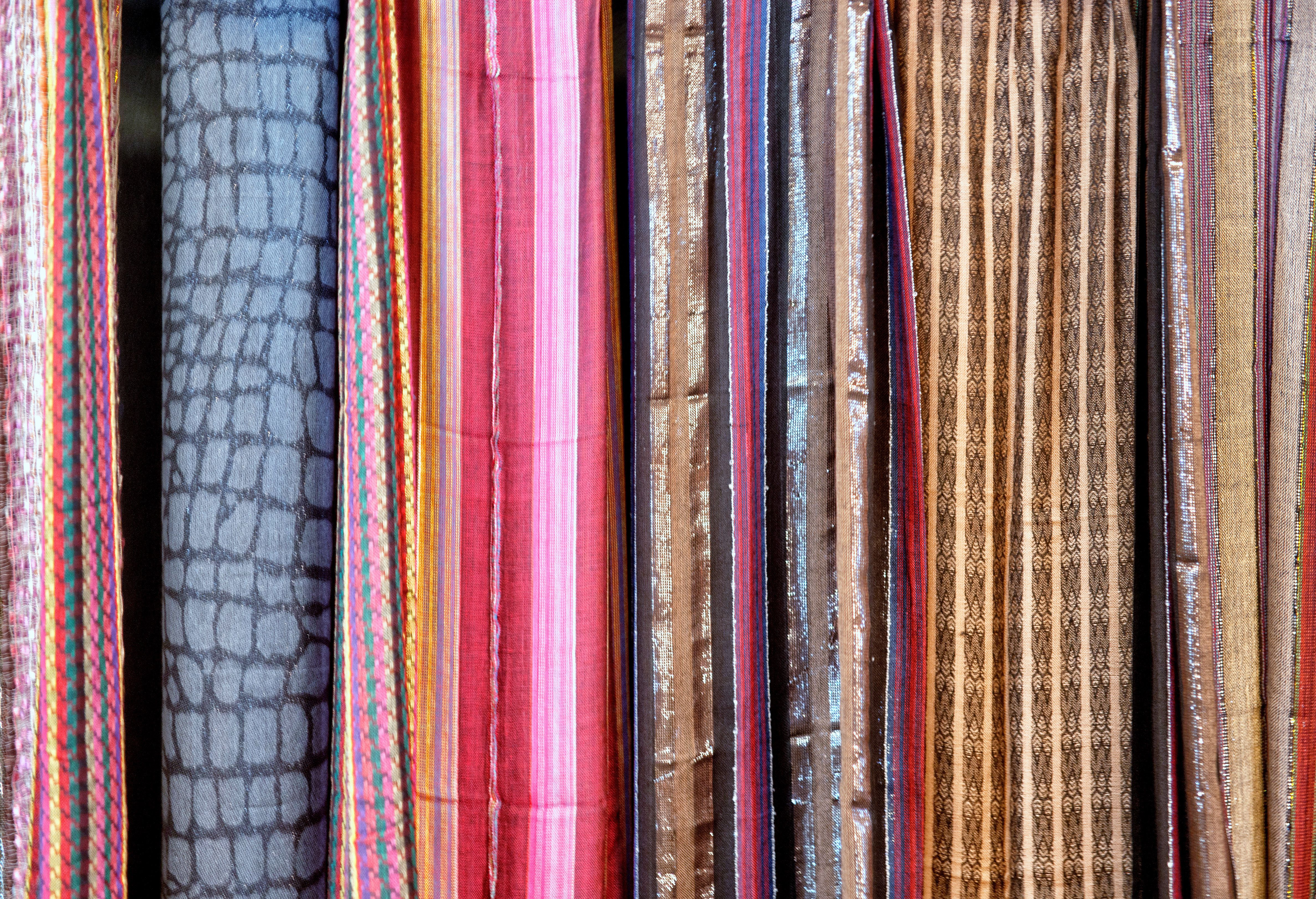 assorted fabric for sale background image - http://www.myfreetextures.com/assorted-fabric-for-sale-background-image/