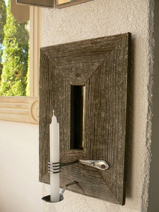Super cool wall sconce. Love the silverware on this ...