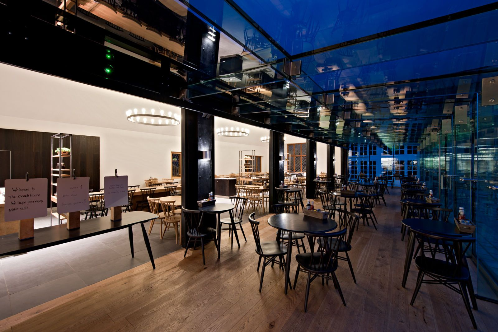 Amazing restaurant interiors by shh appealing coach house restaurant atmosphere in the night
