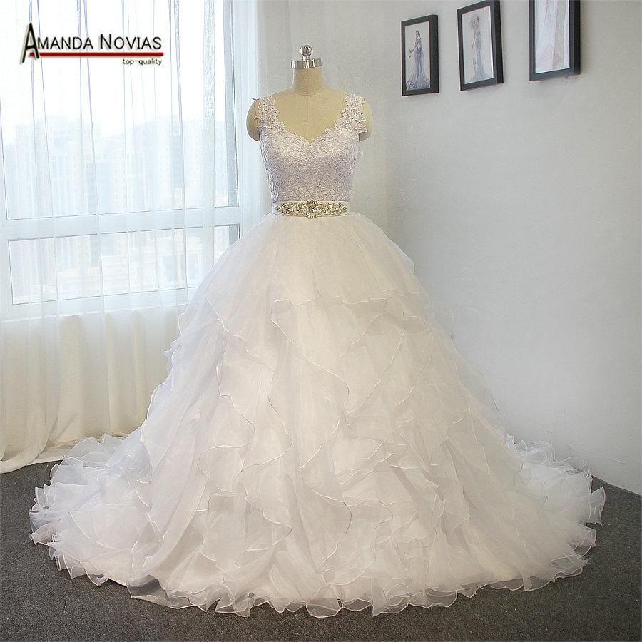 Cap sleeve lace appliques crystal belts ruffle organza wedding dress