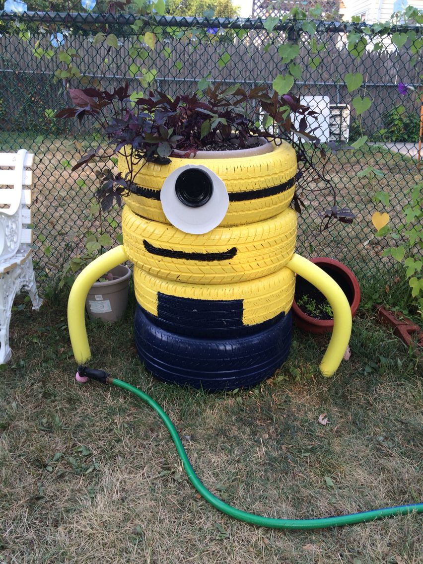 A Minion Made Out Of Tires My Neighbor Was Throwing Away I Used A Can Of Paint Instead Of Spray Paint And A Pool Noodle For The A Pool Noodles Canning