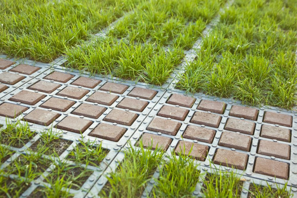 Love The Look But Likely Not Feasible As Not A Product Inset Permeable Squares For Tire Tracks Interesting Permeable Pavers Garden Edging Unique Gardens
