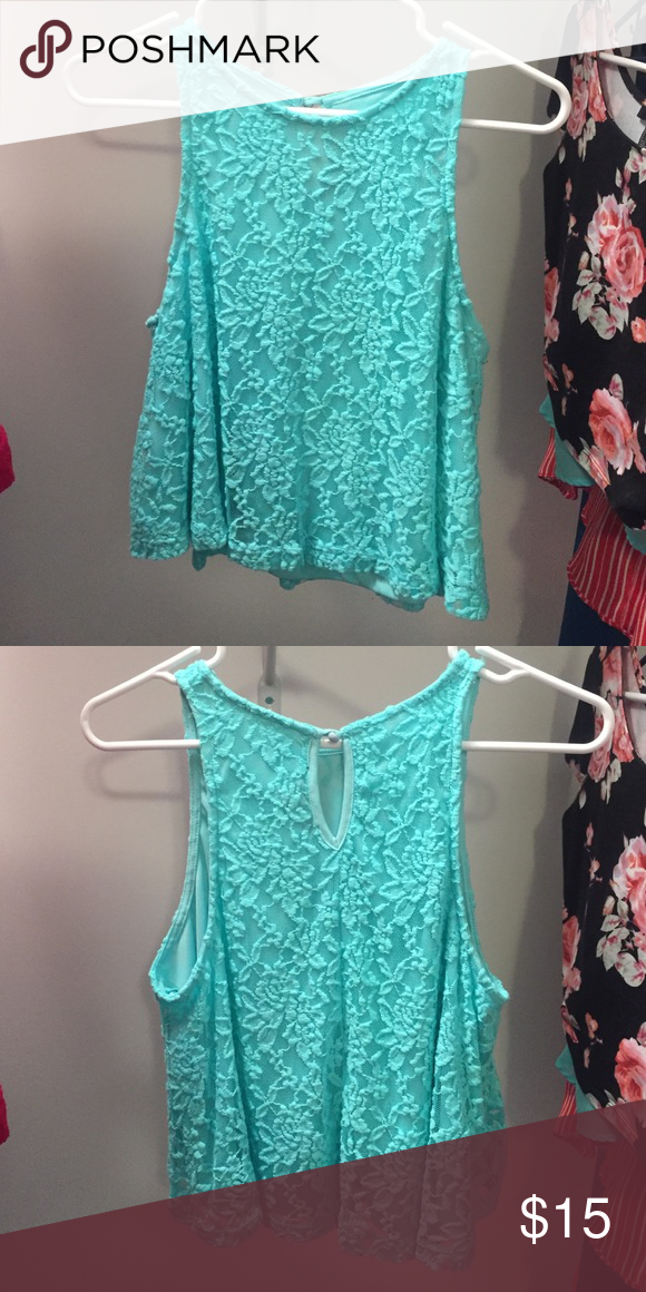 Boutique light blue/teal midriff top From a local boutique, size large. Keyhole on the back, SUPER cute with high waisted jeans and a cardigan or jacket! Tops Tank Tops