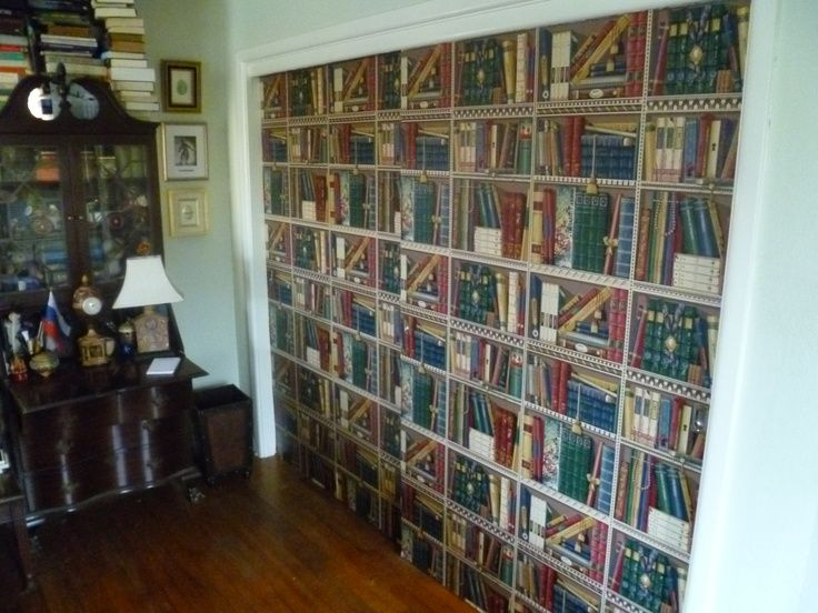 Faux bookshelves. It's just wallpaper on closet doors.