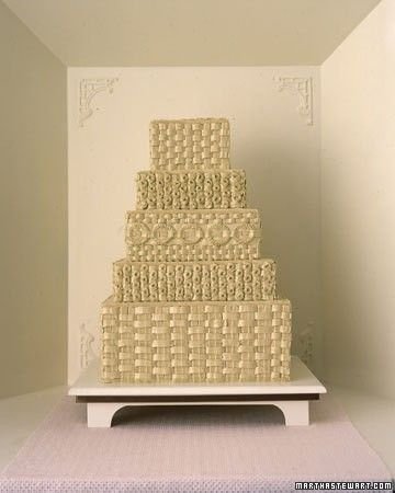 The top and bottom sections of this grand cake display a classic basketweave design, while the thick whorls (made with a petal tip) and braided wreaths (a round tip) of the middle tiers copy the artistry of baskets made by Maine's Wabanaki tribes. Mocha buttercream is also unconventional; along with a brown satin ribbon around the stand, it gives the cake an autumnal air.