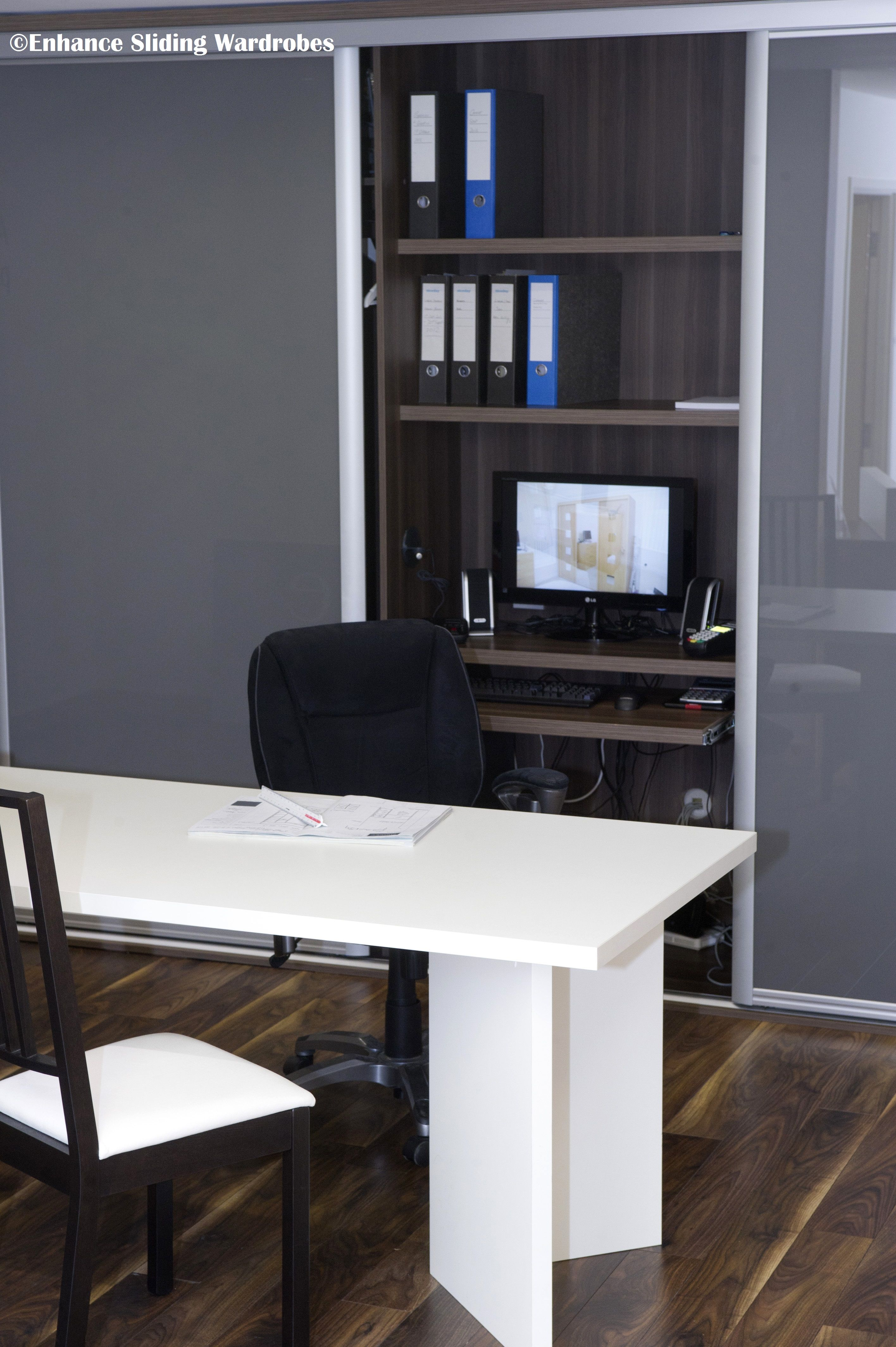 home office in a closet. Grey Glass Sliding Wardrobe #Home Office #Study // Designed By Enhance Wardrobes Home In A Closet