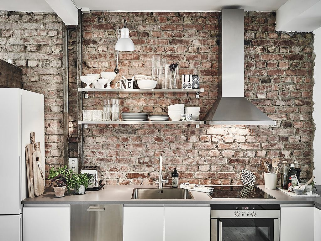 Scandinavian kitchen with brick wall and shelves