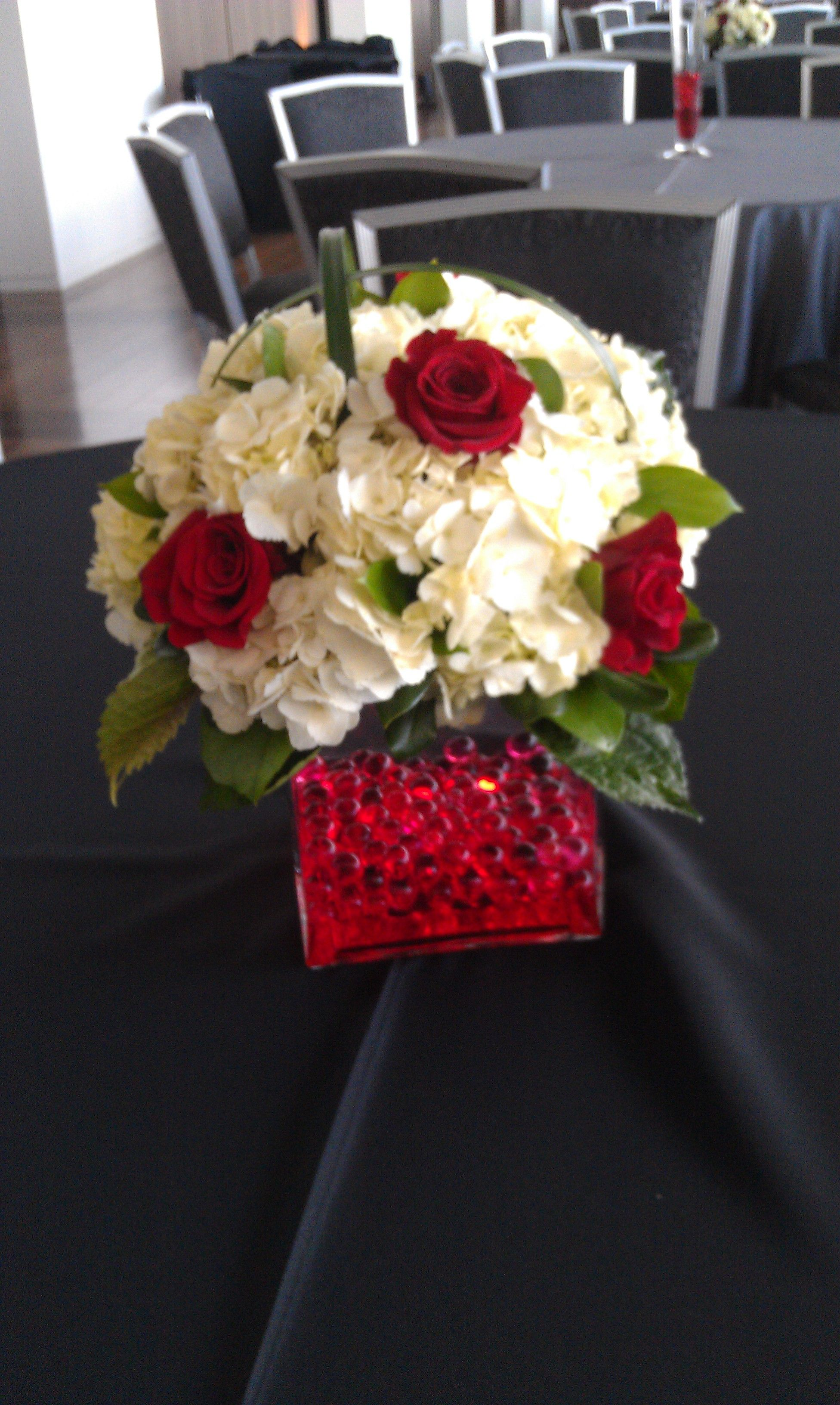 red roses, white hydrangea, red water gems in clear vase by www ...