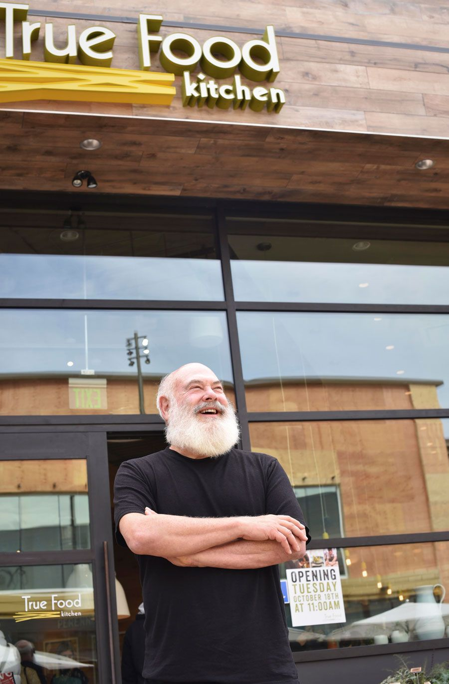 Dr andrew weil stands in front of true food kitchens new