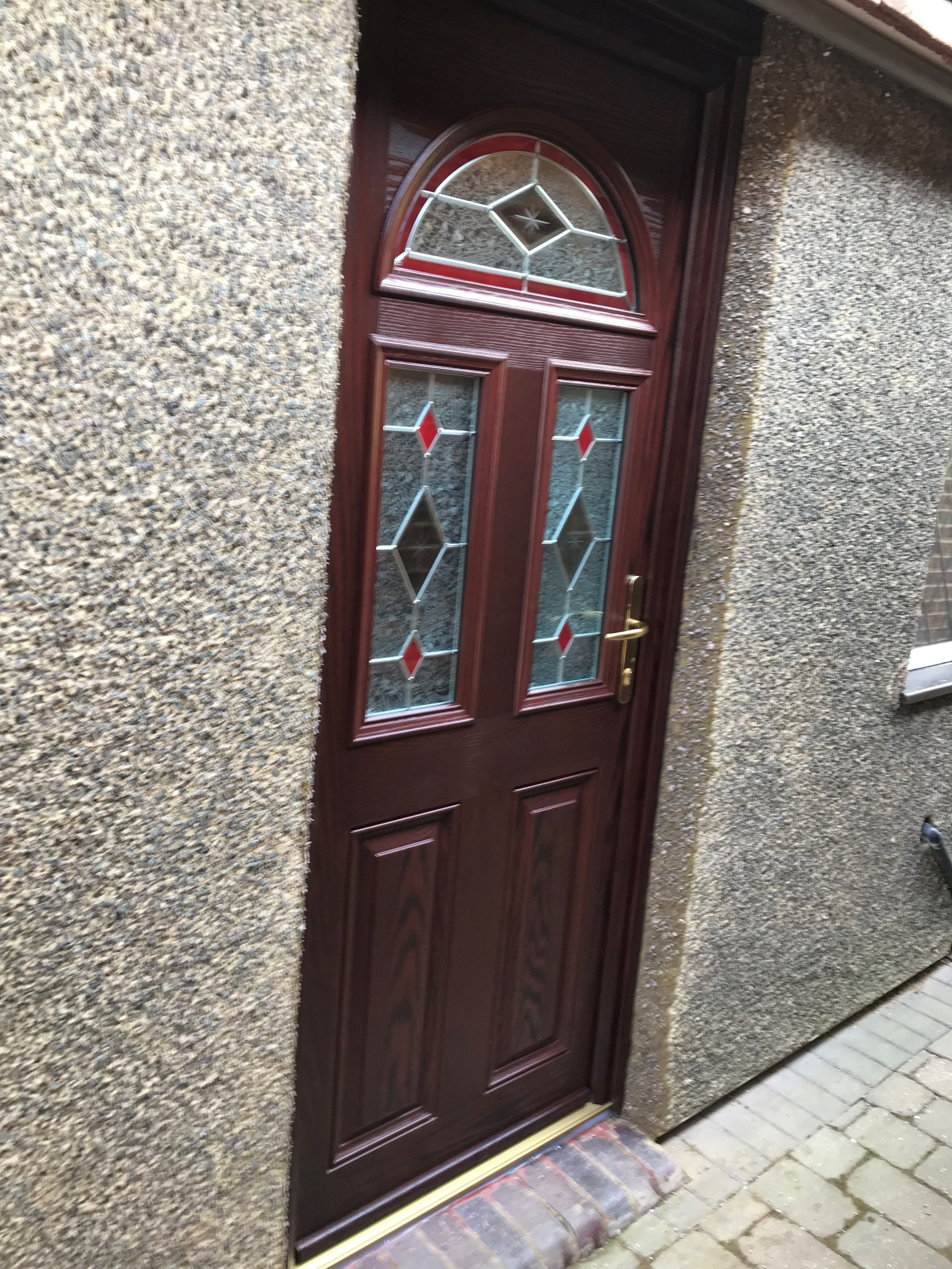 Rosewood composite front door with éclat arch and red accented ...