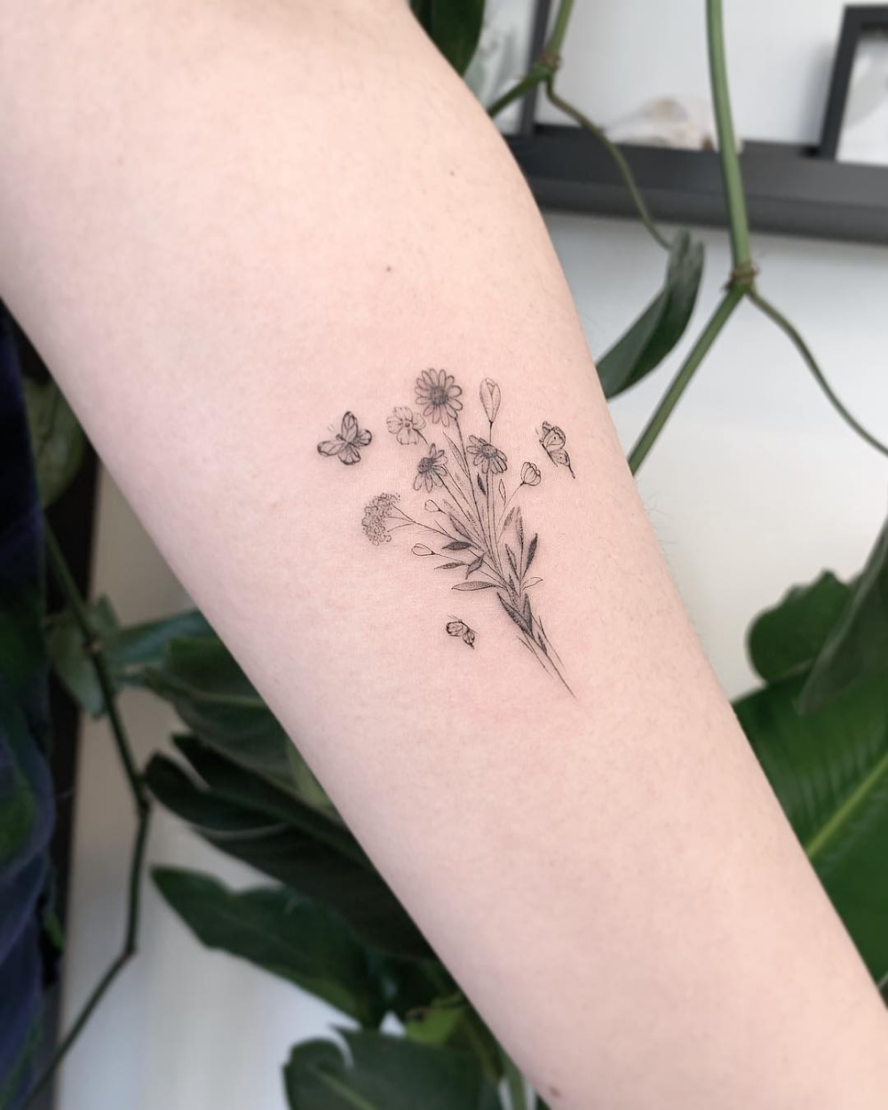 If You Re Looking For A Tiny Minimalist Tattoo Idea In Black Ink Or Color Let These Butter Dainty Flower Tattoos Dainty Tattoos Butterfly With Flowers Tattoo