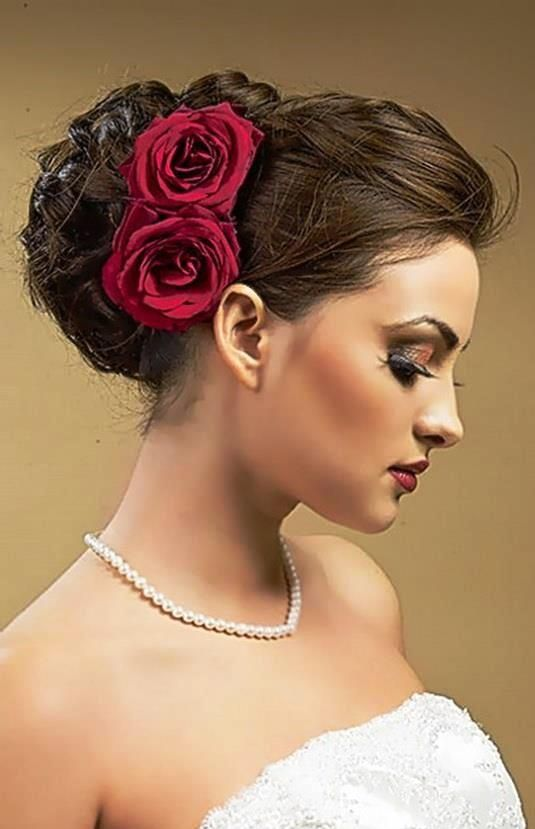 Bride S Braided Updo With Side Red Roses Wedding Hairstyle