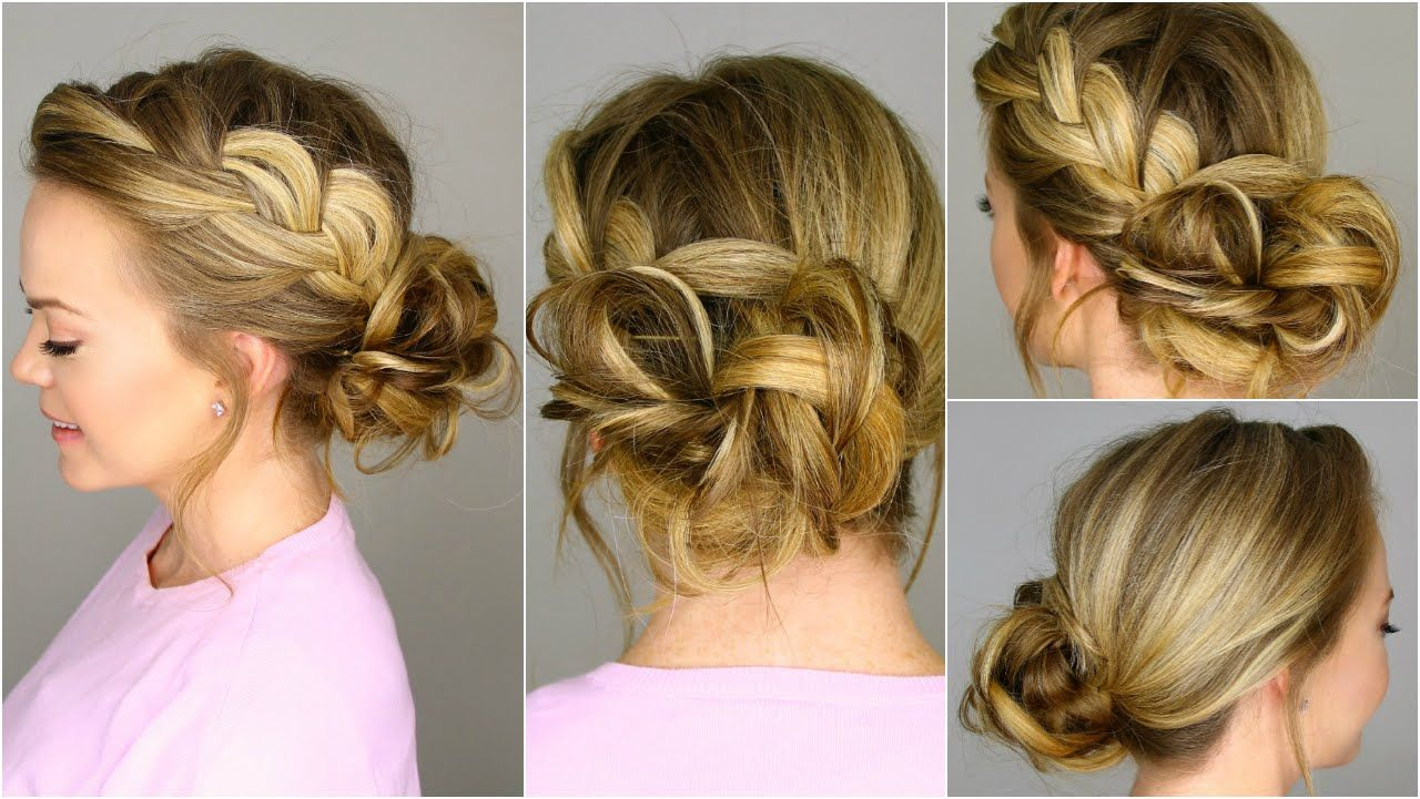 A french braid pulled loose slightly and finished in a messy bun