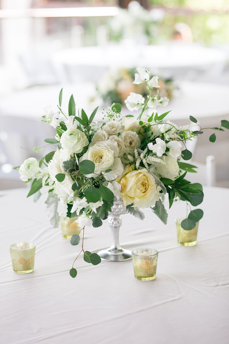 Silver compote vase filled with cream hydrangeas, ivory roses, ivory ...