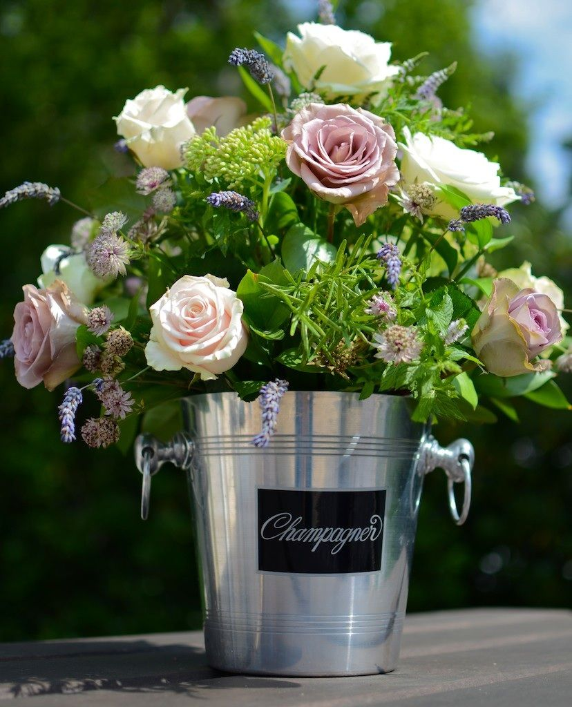 Champagne Bucket Centrepieces With Floral Arrangement Follow Us For More Planning Inspiration Or Contact U Luxury Flowers Wedding Wine Bucket Wedding Flowers