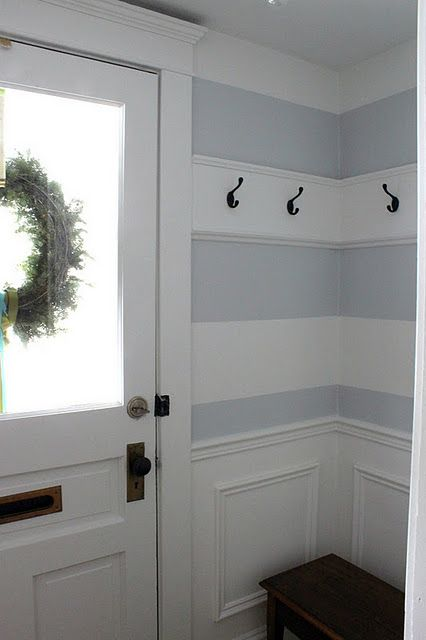 I like how she built out the wall for the hooks, incorporated the hooks into the stripes, and I love the front door.