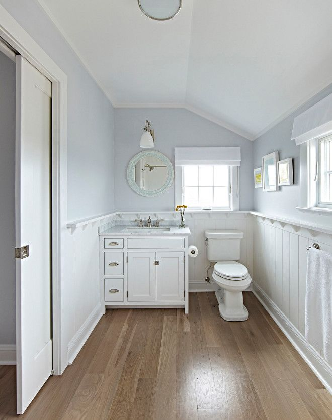 Bathroom Wood Floor And Wainscoting The Master Bathroom Features Wide Plank Solid White Oak Hardwood Fl Wood Floor Bathroom Cottage Bathroom Bathrooms Remodel