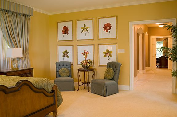 warm yellow home remodel, bedroom #hhi #hhinteriors #remode #design #interiordesign #residential #bedroom #federalstyle #yellow #windowtreatments #wallaccents #paintings #federal #chairs #lounge #warm #carpet #crownmolding #basemolding #accentable #sidetable #lighting