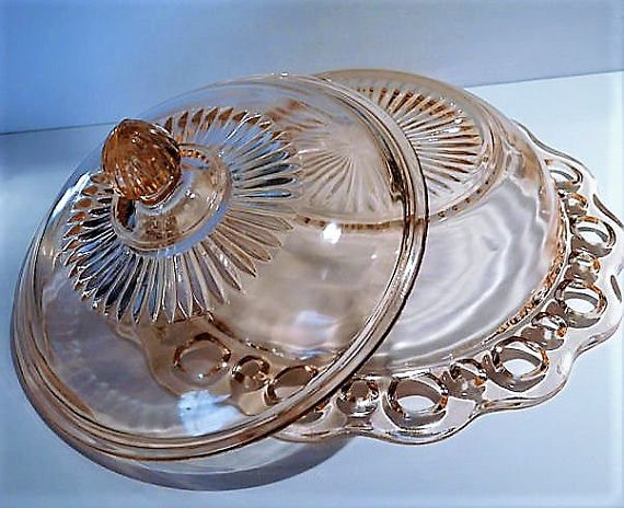 ITEM #RA-93 (Box R-2 ) Pink depression glass round butter dish with lid in the Old Colony aka Lace Edge pattern by Hocking Glass Co circa 1935-38. Base measures 7 3/4 at widest point. Together they stand approx 5 tall. Condition: Very good vintage condition with typical wear due to age and handling. Base is chip free. Lid has typical roughness around the inner lid rim. There is a nick on the lid as seen in last photo, approx 1/4. Piece has been priced accordingly. To find more g...