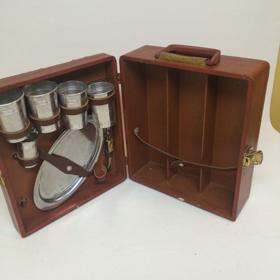 Vintage Ever Wear Travlbar Travel Bar Portable by OldnStuff -  I love the looks of these.  Both etsy and ebay have many vintage types, Amazon and Picnic Time has newer options.