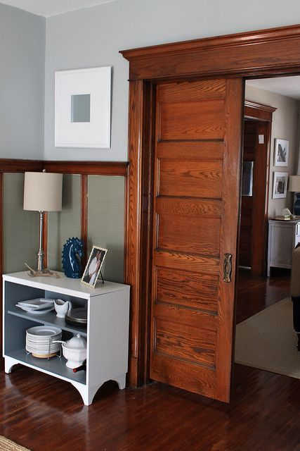 Why I 39 Ll Never Paint Our Wood Trim Wood Trim Grey Wood And Dark Wood Trim Wood Wainscoting Stained Wood Trim