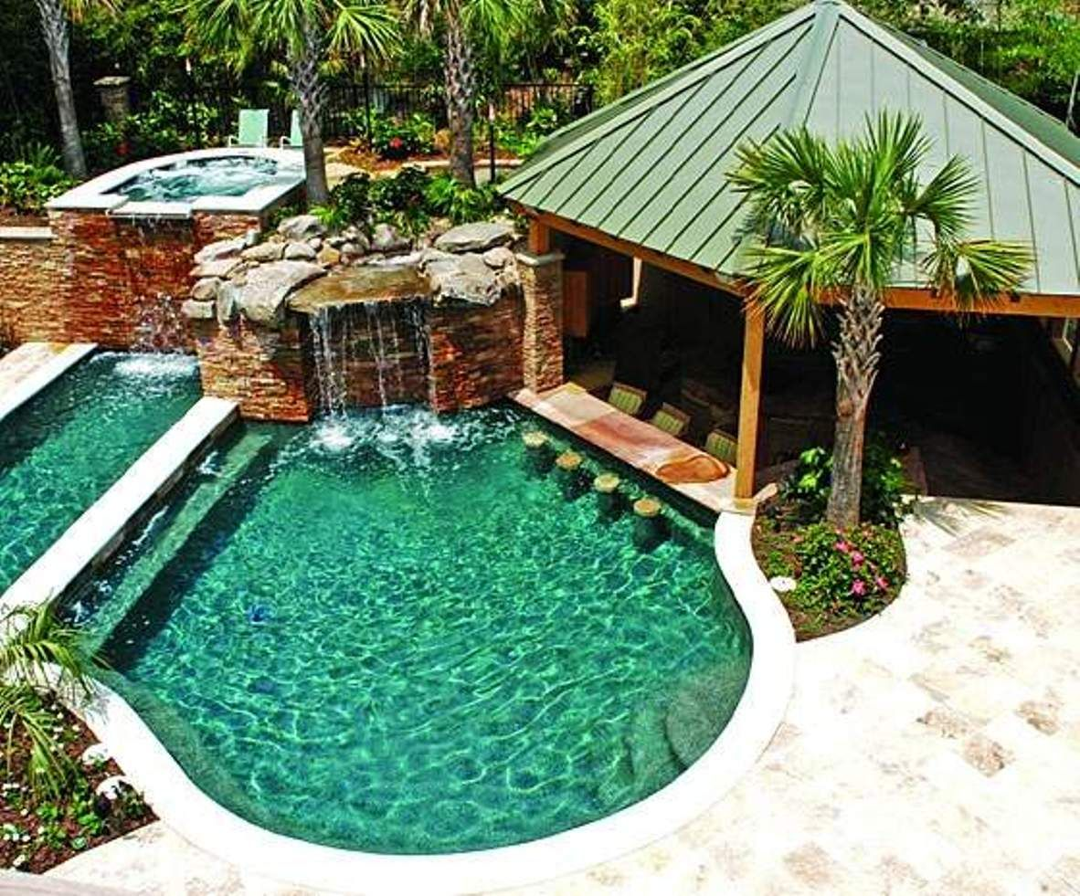 Amazing swimming pool with waterfalls decorating ideas for Pool design with bar