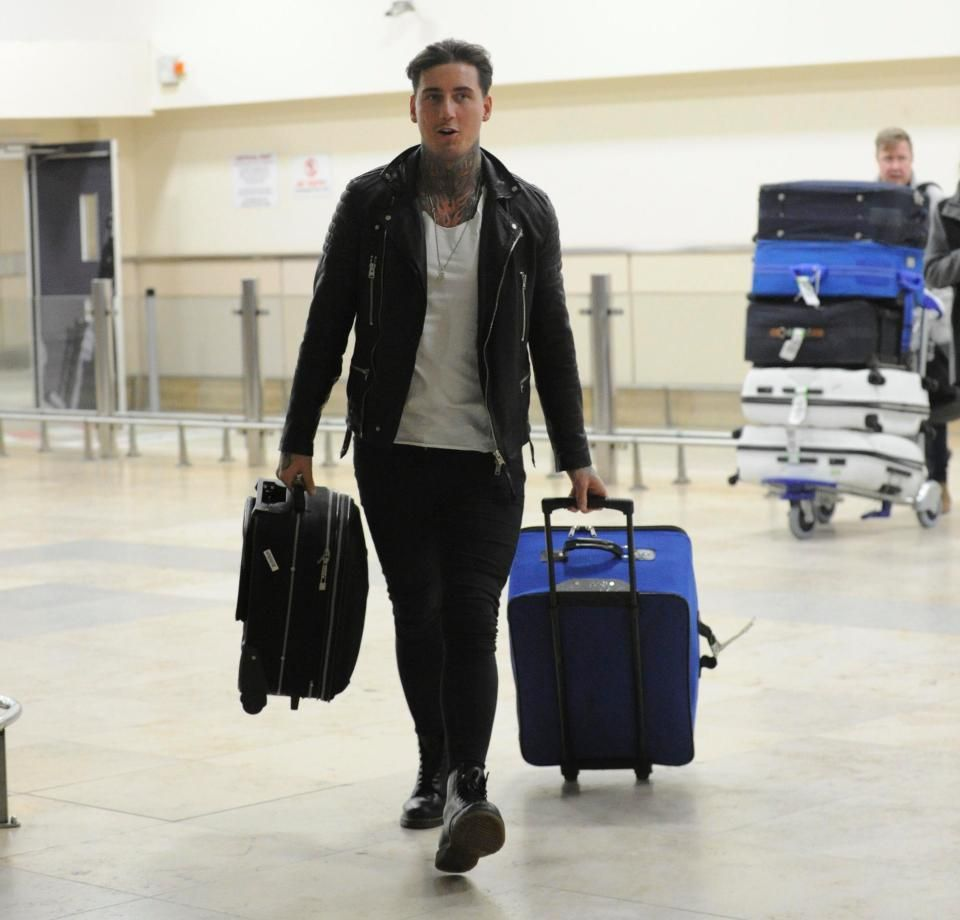 Jeremy McConnell pictured with SEVEN suitcases at Liverpool Airport as he moves to be closer to Stephanie Davis and son Caben-Albi after rekindling romance