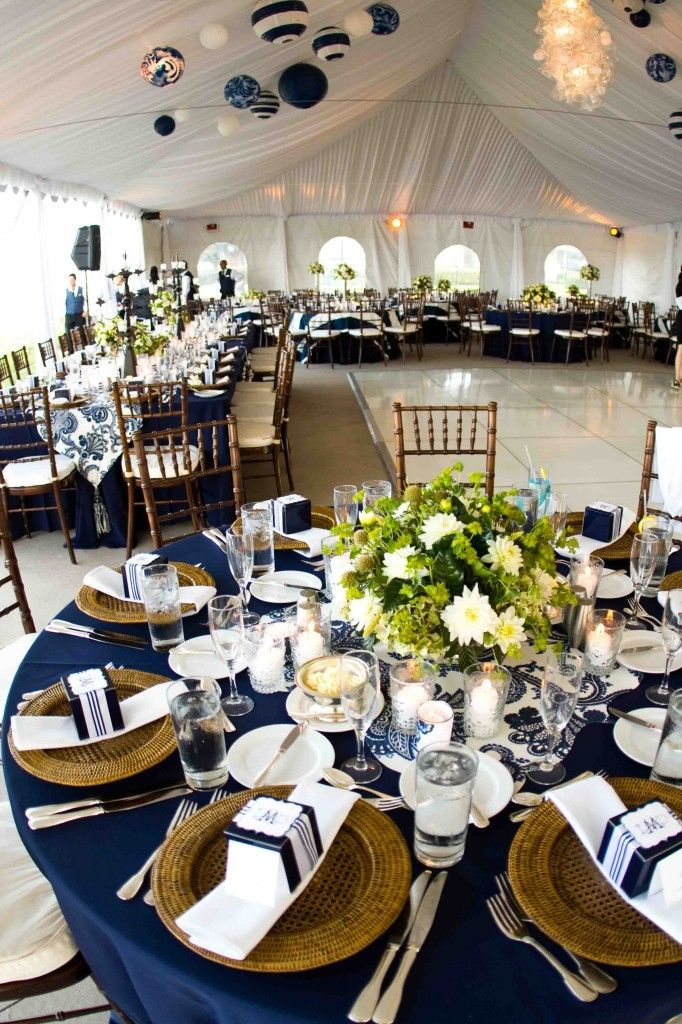 Navy Blue Tablecloths Wooden Chargers And A Hint Of Green Completes This Serene Tablescape