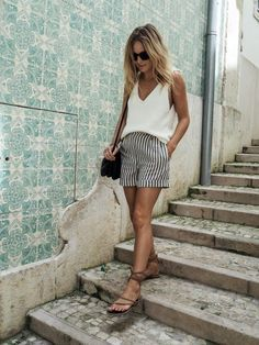 A simple vest and city shorts can go a long way-effortless fashion looks best on holiday.