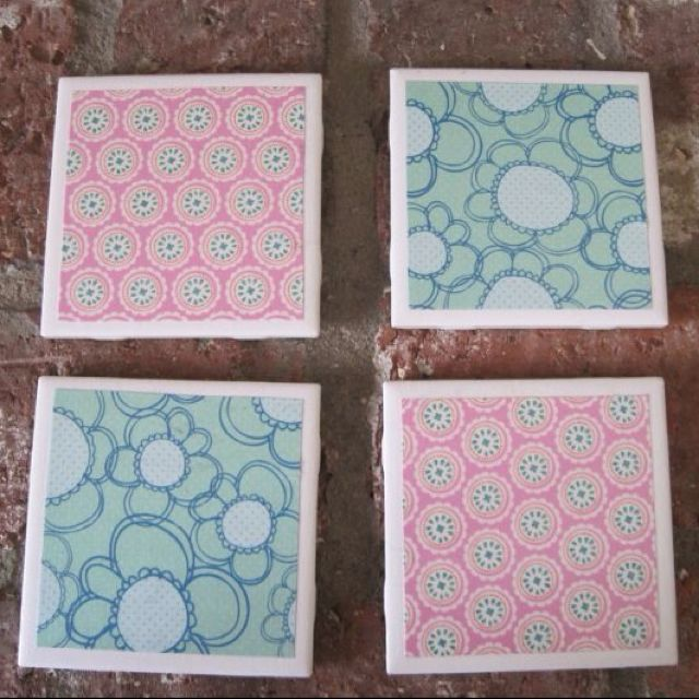 Coasters made with 13 cent tiles, felt on the bottom, scrapbook paper with mod podge and a clear coat of spray paint on the top
