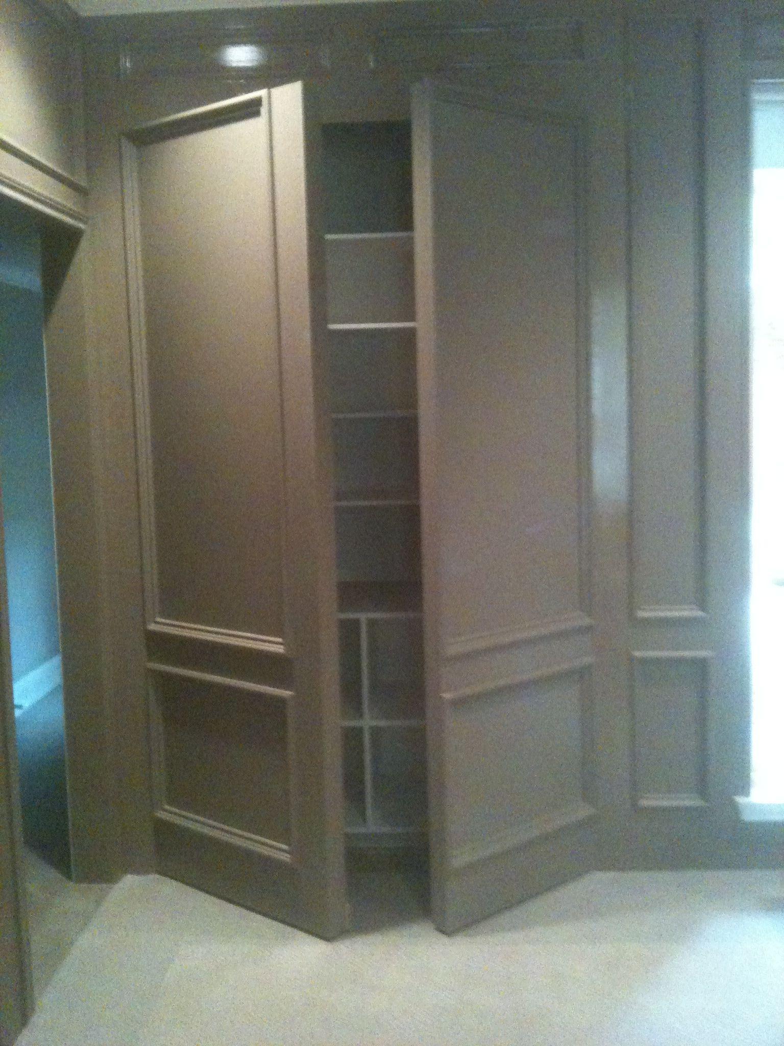 hidden wall door. double wall panel open - media room: single doors flanking the screen hidden door